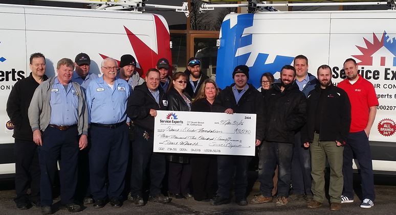 Service Experts of Niagara presents a check to the Heart and Stroke Foundation